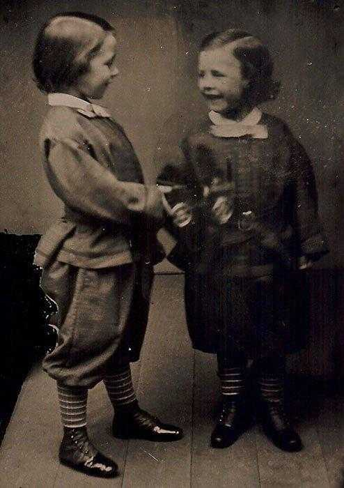 Ambrotype-of-two-children-with-a-toy-train-723x1024